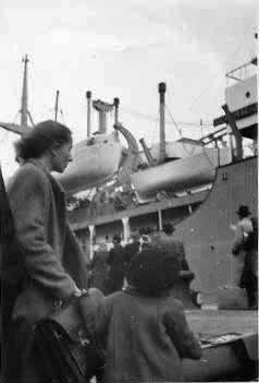 Sophie and son Hank (Vytautas) Endzelis, displaced persons from Lithuania, prepare to board their ship to the U.S. in Tubingen, Germany in 1948
