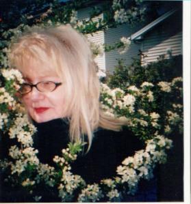 Marita (Stankitis) Brake amid apple blossoms, like her grandmother's