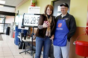 Angela and Darrell Tureskis at Darrell's Salvation Army bell-ringing station