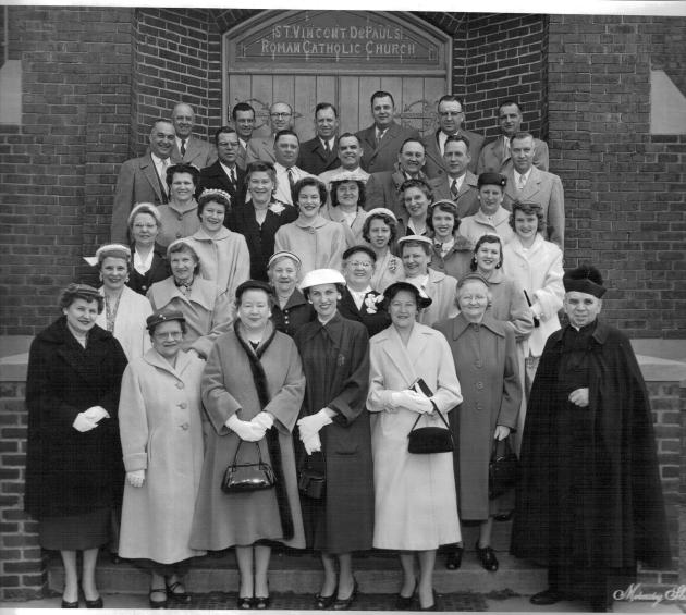 I am told this is a photo of parishioners that includes the church choir. 1956