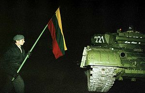 Lithuanian faces Soviet tank with a flag