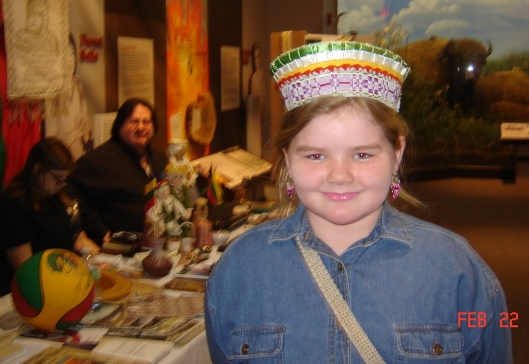 Young Carolyn wears the crown (karuna) of the Lithuanian national costume