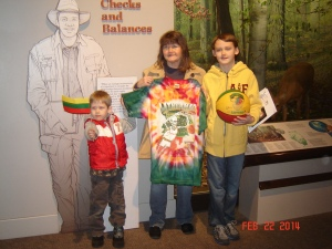 Matejka family with Skullman flag, Skullman jersey and basketball