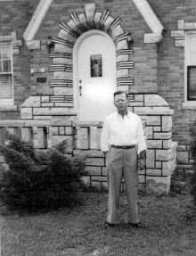 William, Jr. in front of the E. Cook St. family home built from the bricks and stones of the old White City Amusement Park