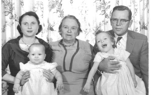 Irene Blazis holding daughter Barbara, William, Jr. holding Mary Agnes, and matriarch Mary (Chunis) Blazis (Stulzinski) in center. 1958