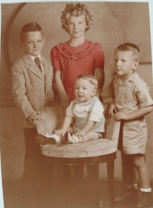 Colleen's mother JoAnn (Mack) Shaughnessy (in red) with brothers (l to r) John, Jr., Jim and Tom.