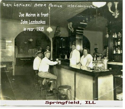 Sam and Mary (Mankus) Lapinski (Lapinskas) behind the bar, 1935