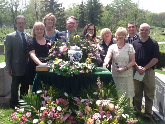 Cooper-White family descendants and spouses Jim, Mary, Krista, John-Steve, Roberta, Kathy, Terri, Michael, and David at Calvary Cemetery with burial urn, May 9, 2014