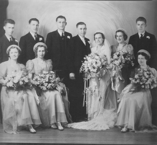 Josephine Yanor wedding to William Stankavich. Anna (Yanor) Carver on the bride's left. Front row second from left may be Monty Yanor.  Late 1930s?