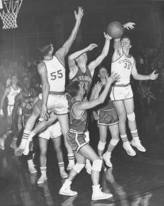 Dick Alane, #35, knocks the ball down for Griffin High School's basketball team, 1958