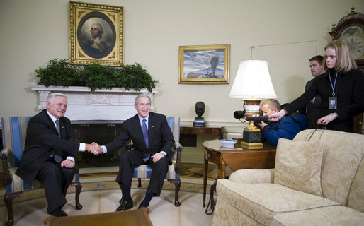 President George W. Bush exchanges handshakes with President Valdas Adamkus of Lithuania, Feb. 12, 2007. White House photo by Eric Draper.