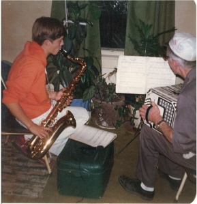 Young David Black plays tenor sax with his grandpa, John Galman, Jr., on concertina, 1979.