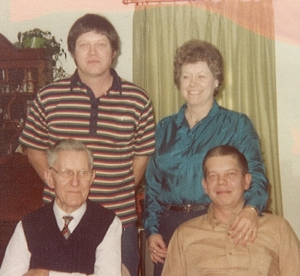 Grandpa John, Jr., bottom left, with sons David, upper left, and John III--and daughter Marilyn.
