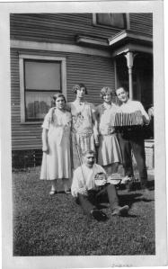 Anna (Klimaitis) Bernotas with her mother, Anna (left) and her sister Adella (right).  Sitting man with fiddle possibly young Anna's husband Peter Bernotas.  Circa 1925.