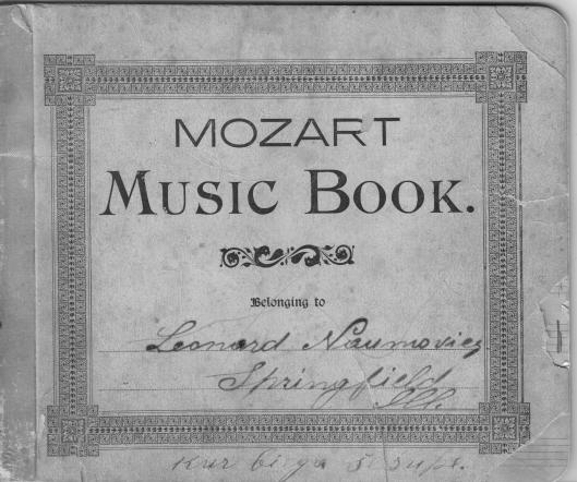 "the cover of Leonard, Sr.'s hand-inked music book. See words ""Kur Bega Sesupe"" at bottom."