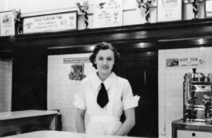 Julia behind the counter at the Woolworth's soda fountain, downtown, Fifth and Monroe Strs., 1930s.