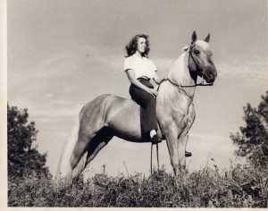 The beautiful Delores Kavirt showing a palomino horse named Pardner, 1940s.