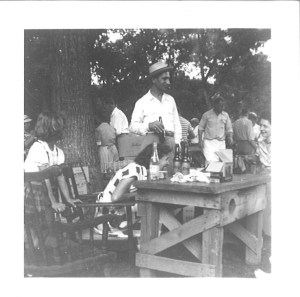 """Frank Pakey chatting up the ladies at """"Lithuanian Lodge"""" picnic, 1950s."""