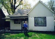 Grandson John Edward Schmidt in front of the Novick house on East Jackson.