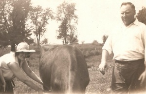 Kaston and Caroline Stockus, c. mid-1930s.with cow