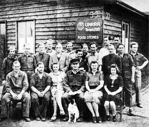 4 UNRRA Food Stores employees at the Lithuanian DP camp in Seedorf. Source albionmich.com
